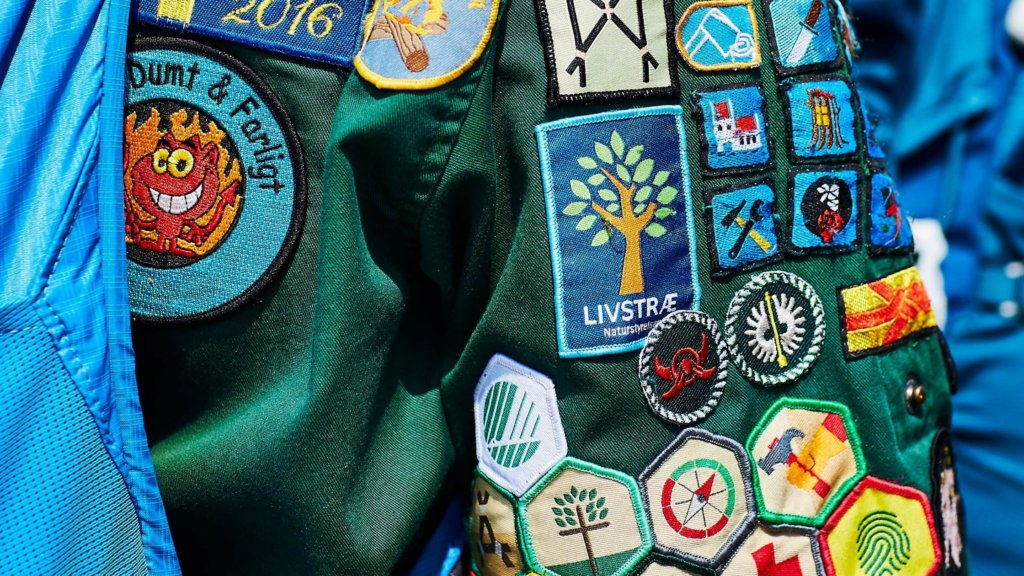 close up of girl scout badges