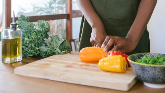 cropped image of someone chopping vegetables